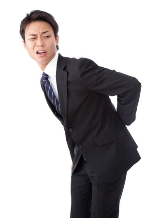 a businessman suffering from low back pain  Stock Photo