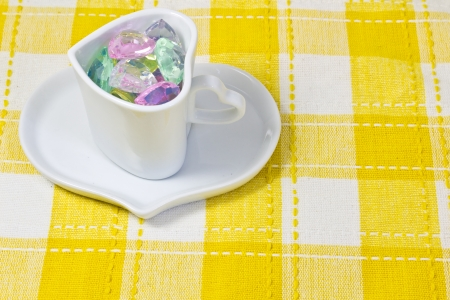 This is a picture of the colorful heart in a cup  photo