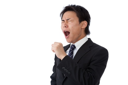 This is a picture of a businessman yawning. photo