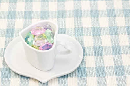This is a picture of the colorful heart in a cup. photo