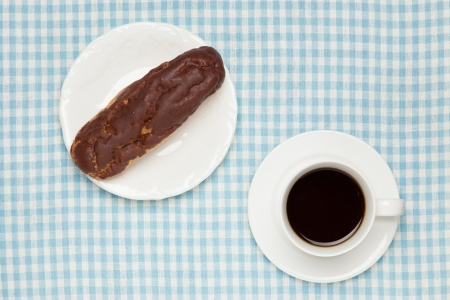 eclair: eclair and coffee on table Stock Photo