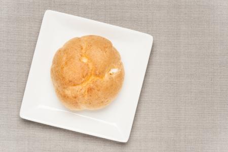 creampuff: cream puff on table