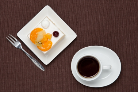This is a photo of a fruits cake and coffee. photo