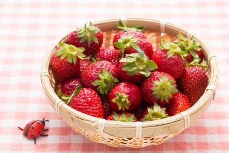 This is a photo of strawberry that was served in a bamboo basket. Stock Photo - 20078516