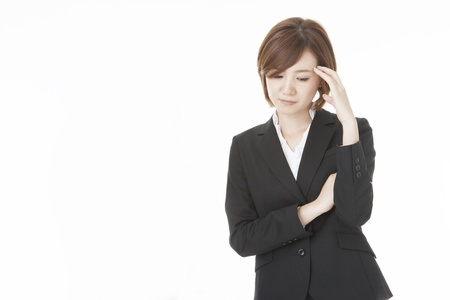 a young business woman suffering from headache. Stock Photo - 20022522