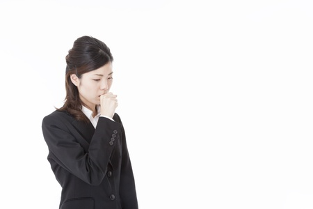 This is a photograph of a young business woman that has a cough. photo