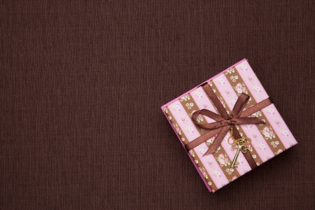 This is a photograph of a gift box striped. photo