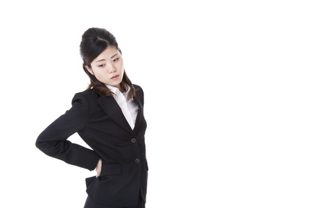 a business woman who are troubled with low back pain. Stock Photo - 20143344
