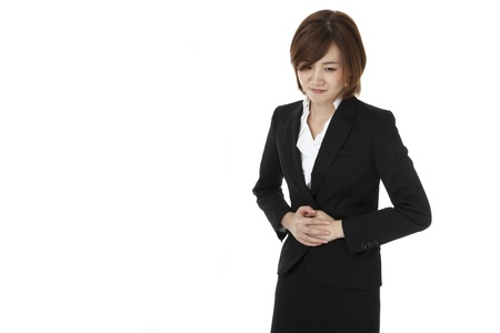 a business woman suffering from abdominal pain.