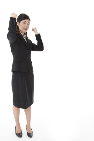 This is a photograph of a young business woman doing a guts pose. photo