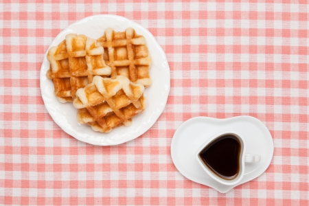 This is a photo of a coffee and waffles.