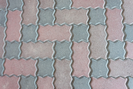 pave: This is a photograph of a pattern of cobblestone.