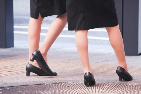 This is a photo of legs of two business women.