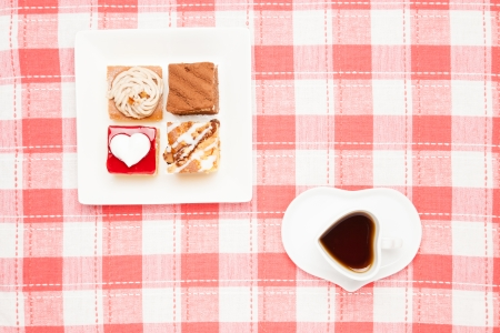 This is a photo of a coffee and shortcakes. photo