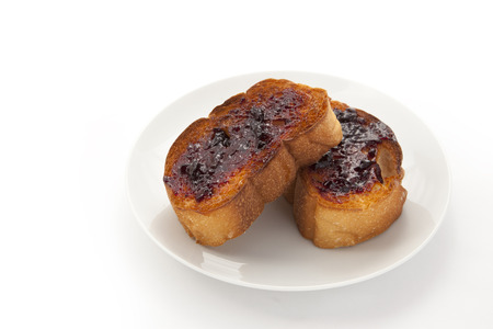 This is a picture of toast with blueberry jam. photo