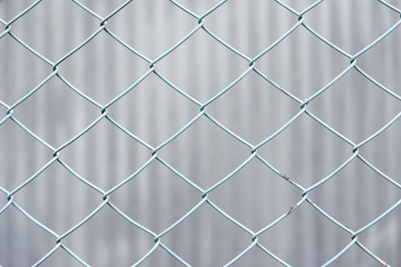 This is a chain-link fence of blue.