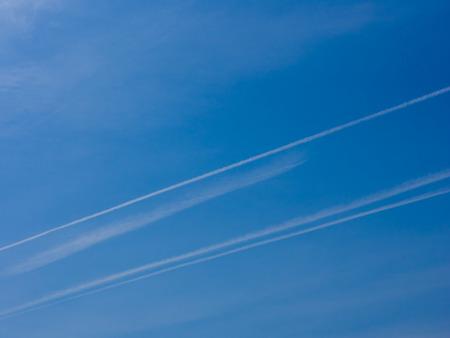 contrail: blue sky contrail floats.