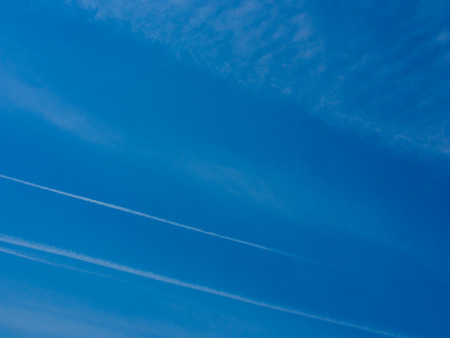 contrail: This is a blue sky contrail floats.