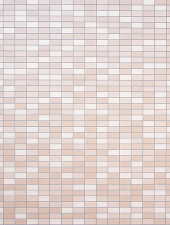 This is a tiled wall of brown and beige. Stock Photo