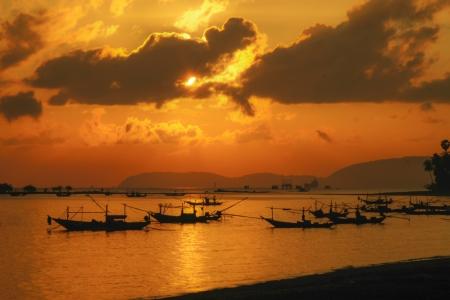 Fishing boats orange sunset light