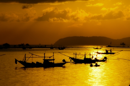 Fishing boats orange sunset light photo