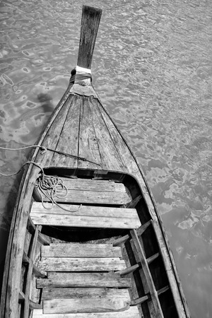 Black and White small boats in sea