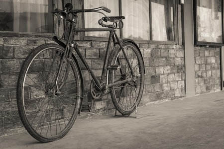 old bicycle near old wall Stock Photo