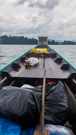 clearer: After the heavy rain for 20-30 mins, this was how things looks like. The sky was clearer, our stuffs were safe under plastic bags prepared by the driver at Chiao Lan Dam, Thailand.
