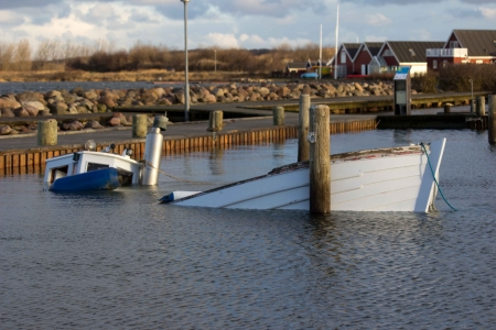 sunk: The The Fishing Trawler is sunk in the harbor after the storm Stock Photo