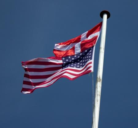 flagpole: Danish and American flags on the same flagpole