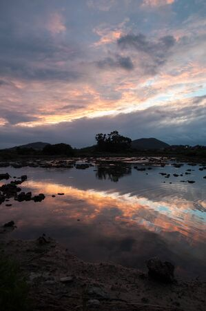 Marshes with hills in the background in north Spain during sunset Banque d'images - 144174807