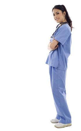 Full length of an Asian female doctor standing against isolated white background