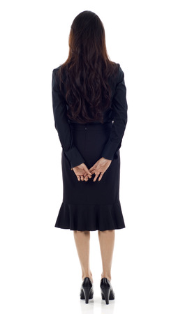 backwards: Asian business woman standing backwards isolated over white