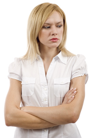 Angry business woman with her arms crossed isolated over white background 免版税图像