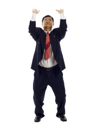 Senior Asian business man holding something up over a white background