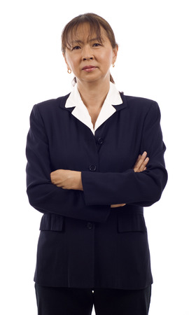 Portrait of a Angry senior Asian business woman with arms folded isolated over white background photo