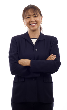 Portrait of a confident smiling senior Asian business woman with arms folded isolated over white background photo