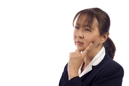 Asian American senior businesswoman thinking against white background Stock Photo