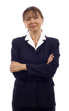 Portrait of a confident senior Asian business woman with arms folded isolated over white background photo