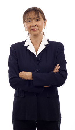 Portrait of a confident and serious looking senior Asian business woman with arms folded isolated over white background