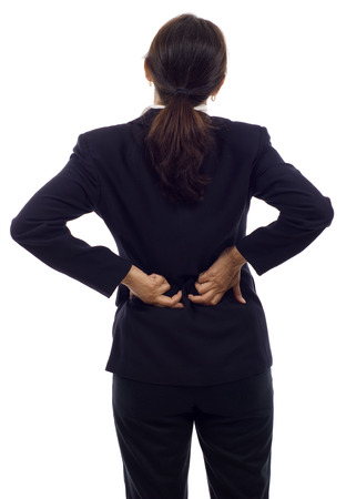 back ache: Asian businesswoman with back pain isolated over white background Stock Photo