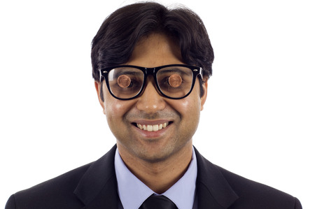 Business Concept: My 2 cents - My View  Smiling Indian business man wearing a black glasses with two cents on it , isolated over white background Stock Photo
