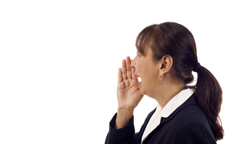 Mature Asian business Woman shouting isolated over white background photo