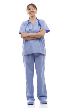 Smiling mature Asian woman health care worker standing isolated over white background