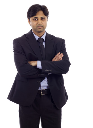 considerate: Portrait of an Indian business man isolated over white background. Studio shot. Stock Photo