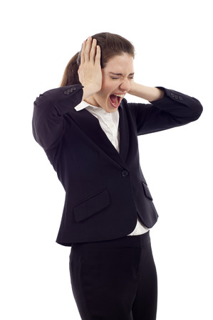 hands over ears: Beautiful young business woman screaming, Hands at her ears, mouth wide open, eyes closed isolated over white background