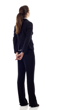 left behind: Hispanic, Caucasian mixed business woman from the back - looking at something over a white background Stock Photo