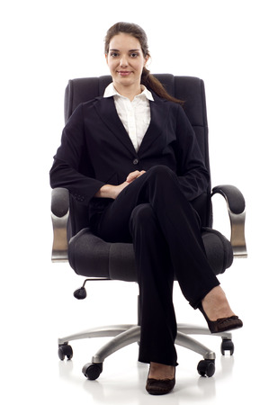 director chair: Young confident business woman sitting on a chair isolated on white