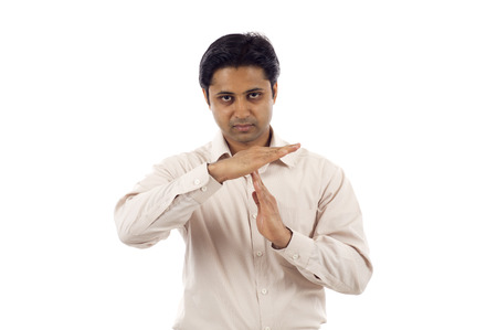 timeout: Serious looking young indian business man signaling time-out