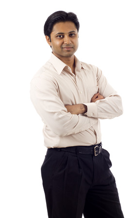 Portrait of a confident Indian business man with hands folded isolated over white background Stock Photo
